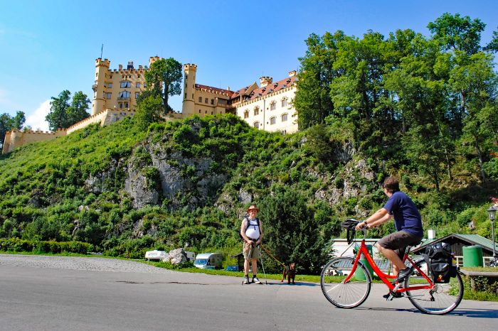 Cyclist in front of Castle Hohenschwangau
